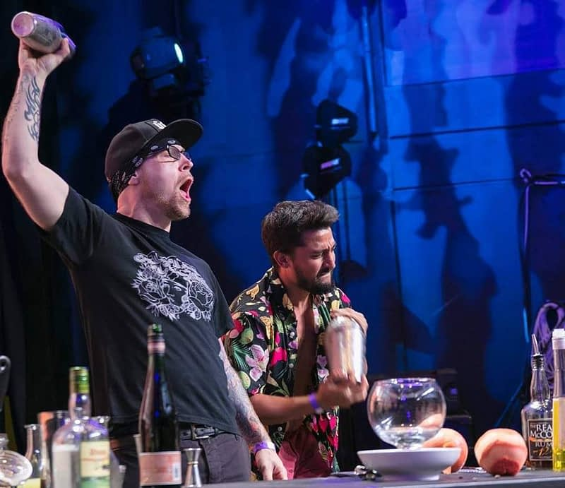 Image of Vincent Vee shaking a cocktail at the 2018 NY Cocktail Expo's Tiki Throwdown Competition.