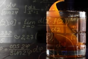 A picture of an old-fashioned style cocktail with a large orange twist served in a rocks glass is overlaid with images of complicated mathematical equations.